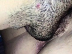 Giving her hairy pussy some...